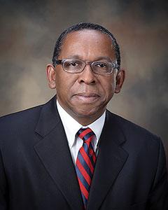 Dr. Reynold Verret